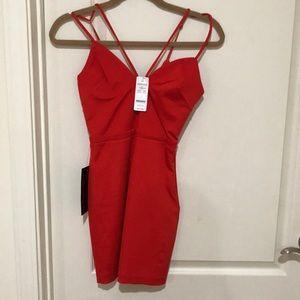 Brand new Bebe mini dress in red